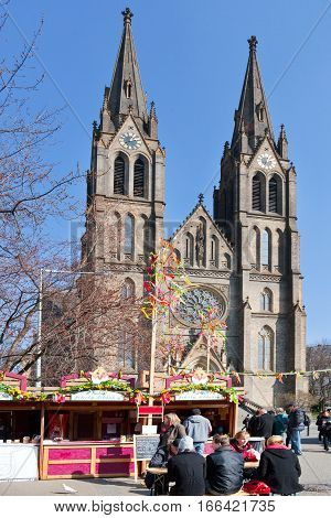 CZECH REPUBLIC PRAGUE - MARCH 18 2016: famous easter market at St. Ludmila church Mirove square Prague Czech republic. Traditional celebration of easter holiday in historical center of Prague (UNESCO).