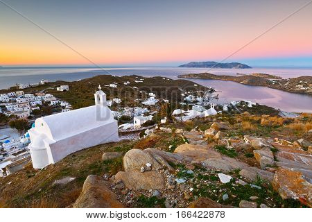 View of Chora on Ios island early in the morning. Sikinos island can be seen on the horizon.