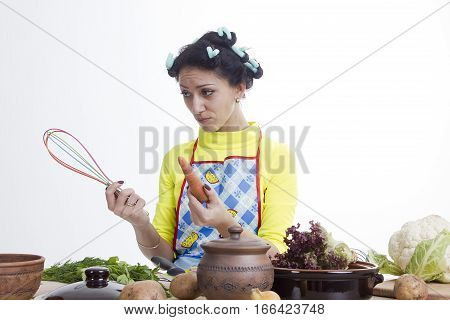 Housewife is preparing in the kitchen on a white background