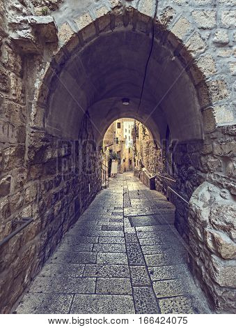Ancient narrow street in old city of Jerusalem, Israel