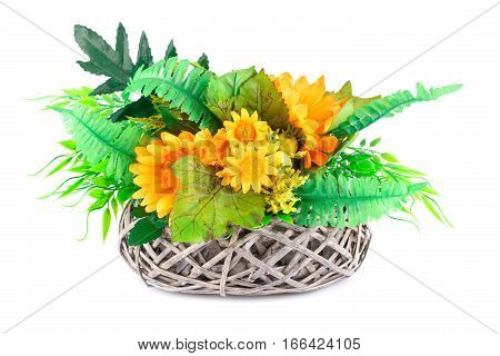 Fabric daisies in wicker basket isolated on white background.