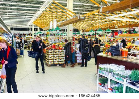 Vilnius, Lithuania - January 6, 2017: The People choosing products in Maxima Shop at Vilnius Akropolis schopping house on January 6, 2017. This shopping center is very popular with locals and tourists.