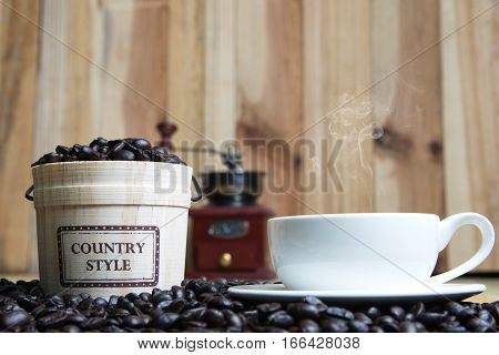 Coffee Cup And Coffee Beans With Casks