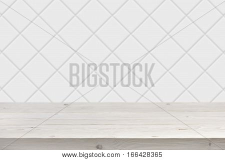 Blurred white tile wall background with wooden planks in front