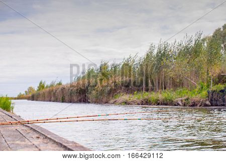 Fishing rods on the background of beautiful scenery