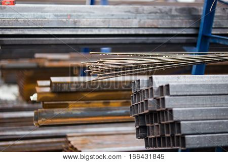 Rust steel rod or bars in outdoor warehouse, close up photo