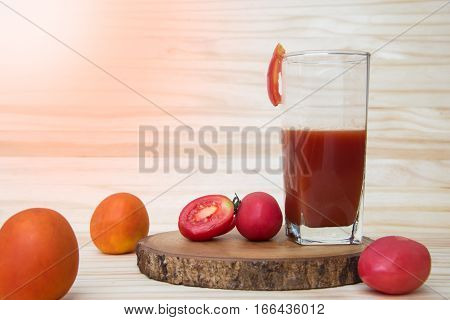 Fresh red tomato juice in the glass