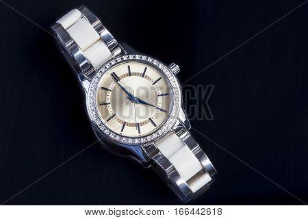 Lady luxury watch on a black background.