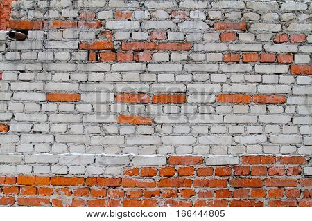 Background of old brick wall with white and red bricks