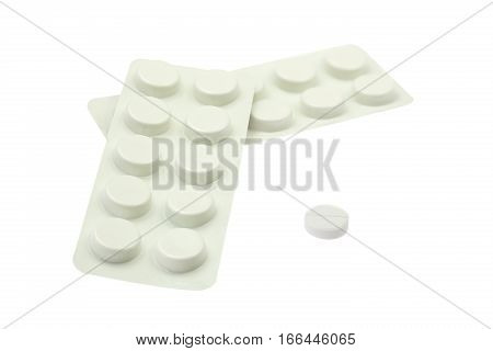 White tablets in packaging, closeup on white