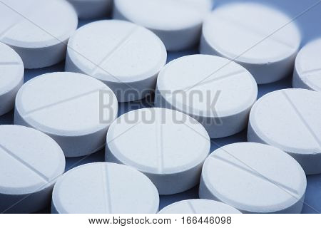 Group of large white tablets closeup shot