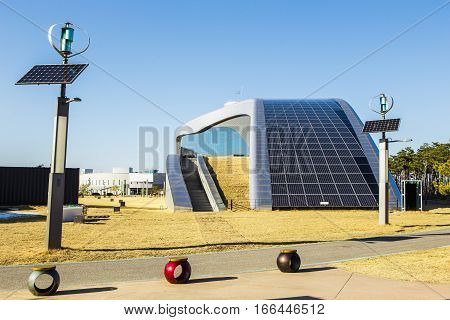 Solar panels and wind turbine on background blue sky. Alternative sources of electricity.