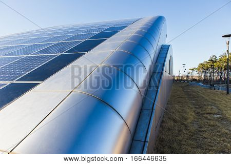 Solar panels on the roof of the building, alternative sources of electricity, advanced technology.
