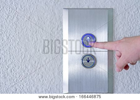 Using hands press the elevator up and keypad elevator and bottom key