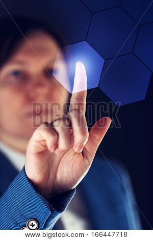 Businesswoman working in futuristic cyberspace hightech environment hand pushing interface button