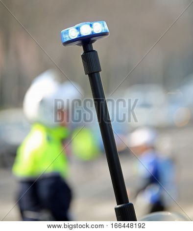 Flashing Siren Of Motorcycle Police And A Traffic Officer On The