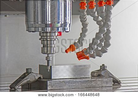 CNC machining center setting center bar after cutting metal