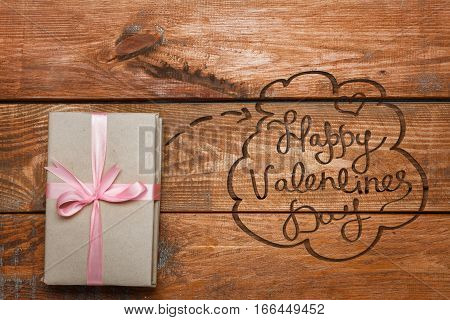 Valentines Day gift in box on wooden background
