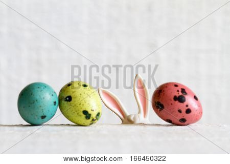 Easter eggs and bunny ears abstract background on white boards