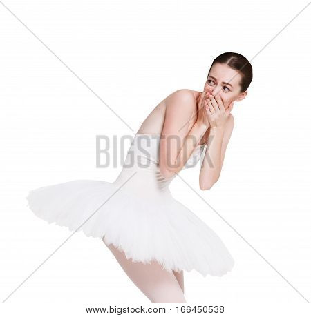 Confused laughing ballerina portrait against white background, isolated. Professional dancer in tutu skirt shows facial emotion, makes fun of someone. Choreography classes