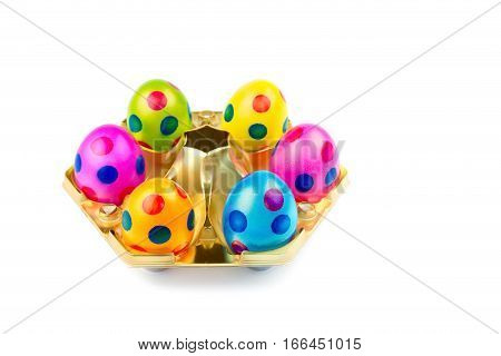 Several painted easter eggs in gold tray isolated on white background