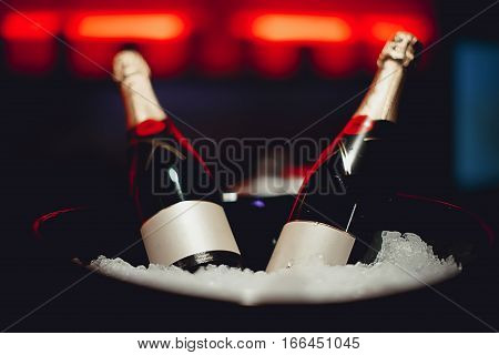 A concept of luxury life with champagne bottle in ice silver bucket