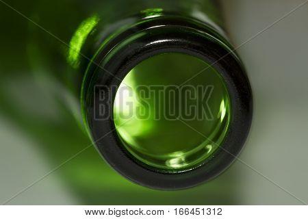Green bottle neck macro view on white background