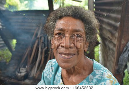 Happy elderly indigenous Fijian woman in her 70's smile. According to 2015 WHO data The life expectancy in Fiji is: Male 67 female 73 and total life expectancy is 70. Real people copy space