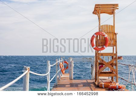 life guard tower at the eand of pier sky background