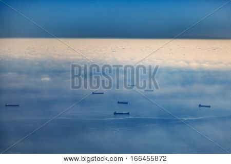 Ship fleet on the sea with clouds and clear sky form high angle.