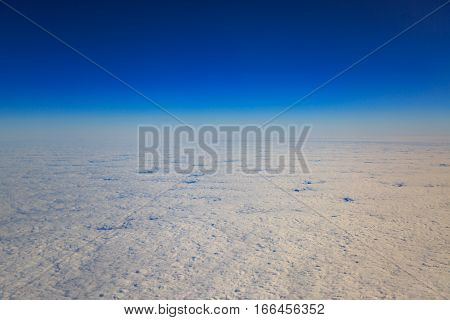 Atmospheric cloudscape view from high sky covers the earth.