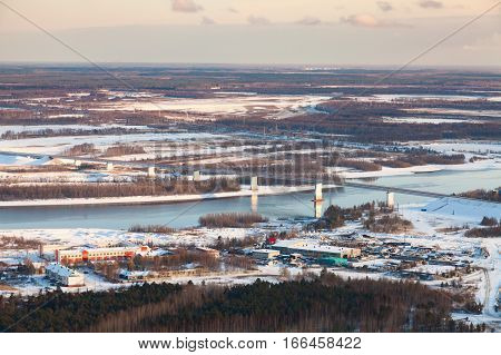 Bridge over a river in Western Siberia in the early winter, top view