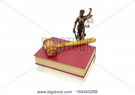 Justice statue book and judges gavel on a white background. horizontal photo.