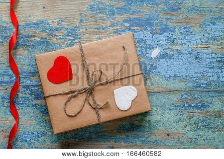 Gift box with hearts and red ribbon. Valentine's Day Concept