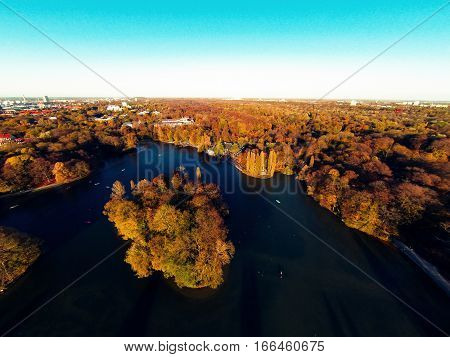 aerial view of urban park with lake
