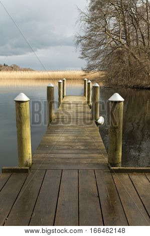 Small landing stage at the river Gudenaa Denmark