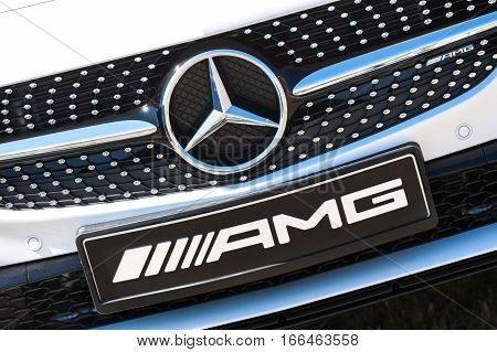 LAVERSTOKE, UK - AUGUST 25: Manufacturer nameplate and grille on a luxury Mercedes AMG at the CarFest motoring event in Laverstoke UK on August 26, 2016