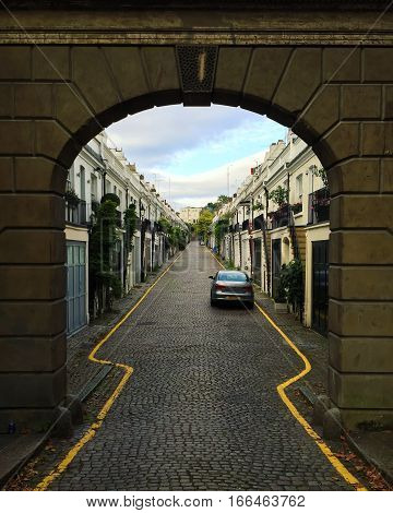 Archway to a small Notting Hill street in London