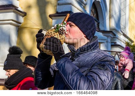 Uzhgorod Ukraine - January 19 2017: Greek-Catholic parishioner drink blessed water after its consecration during the celebration of the Epiphany Day. Epiphany Day completes the Christmas-New Year festivities cycle in Ukraine.