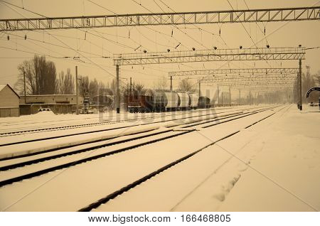 View on a railroad tracks on winter. Retro style