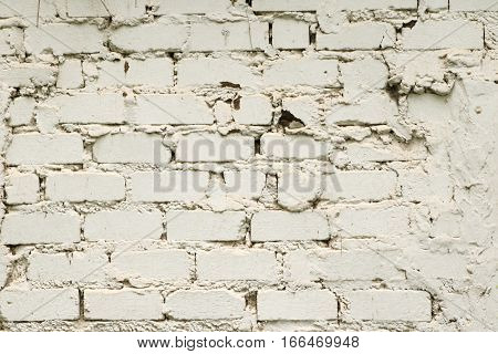 White painted grunge old brick wall textured background