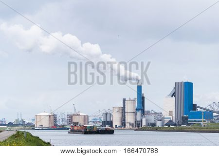 ROTTERDAM NETHERLANDS - MAY 14 2016: Large industrial complex on the rotterdam Maasvlakte the entrance of the Port of Rotterdam