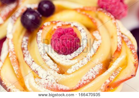 apple muffin with blueberries  and raspberry in the center