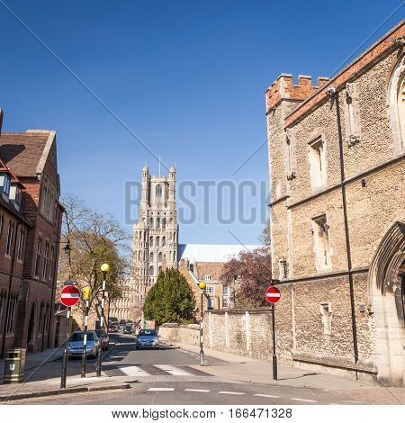The historic streets of Ely Cambridgeshire UK on a bright and sunny spring day. The Kings School buildings are in the foreground with the famous City cathedral in the centre background.