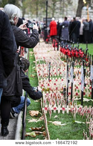 LONDON UK - 13 NOVEMBER 2010: Mourners and ex-servicemen paying tribute to the war dead ouside Westminster Abbey near the London Cenotaph on Whitehall.
