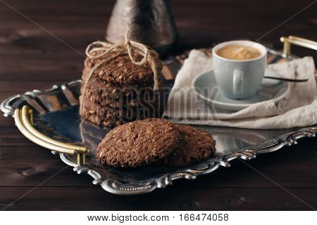 Evening with coffee and oat cookies on plate