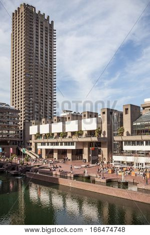 LONDON UK - 24 FEBRUARY 2011: A view of the rear lakeside of the major London cultural centre The Barbican with its recognisable Brutalist architecture and residential towers.