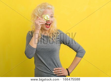 Woman with a condom covering one eye