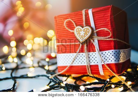 gift is on the table, a garland in the background