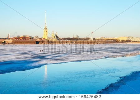 SAINT-PETERSBURG, RUSSIA, JANUARY 21, 2017: People walk on the Neva River ice. On the background is Saints Peter and Paul Fortress